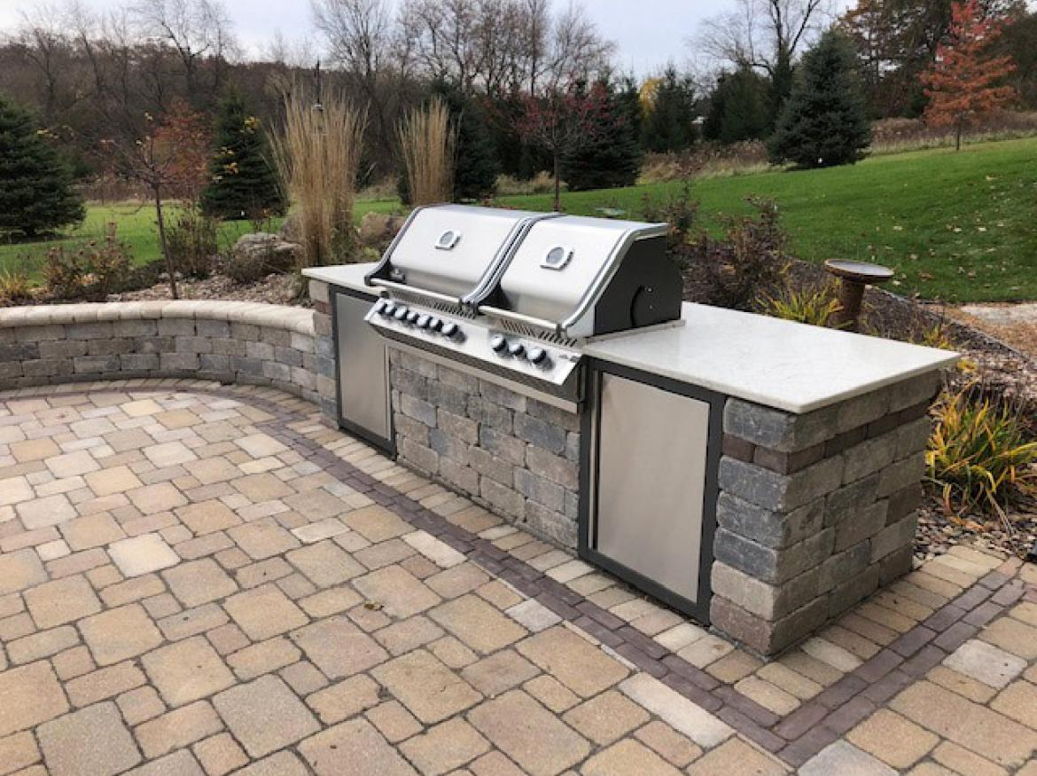Paver patio with fire pit and outdoor kitchen.