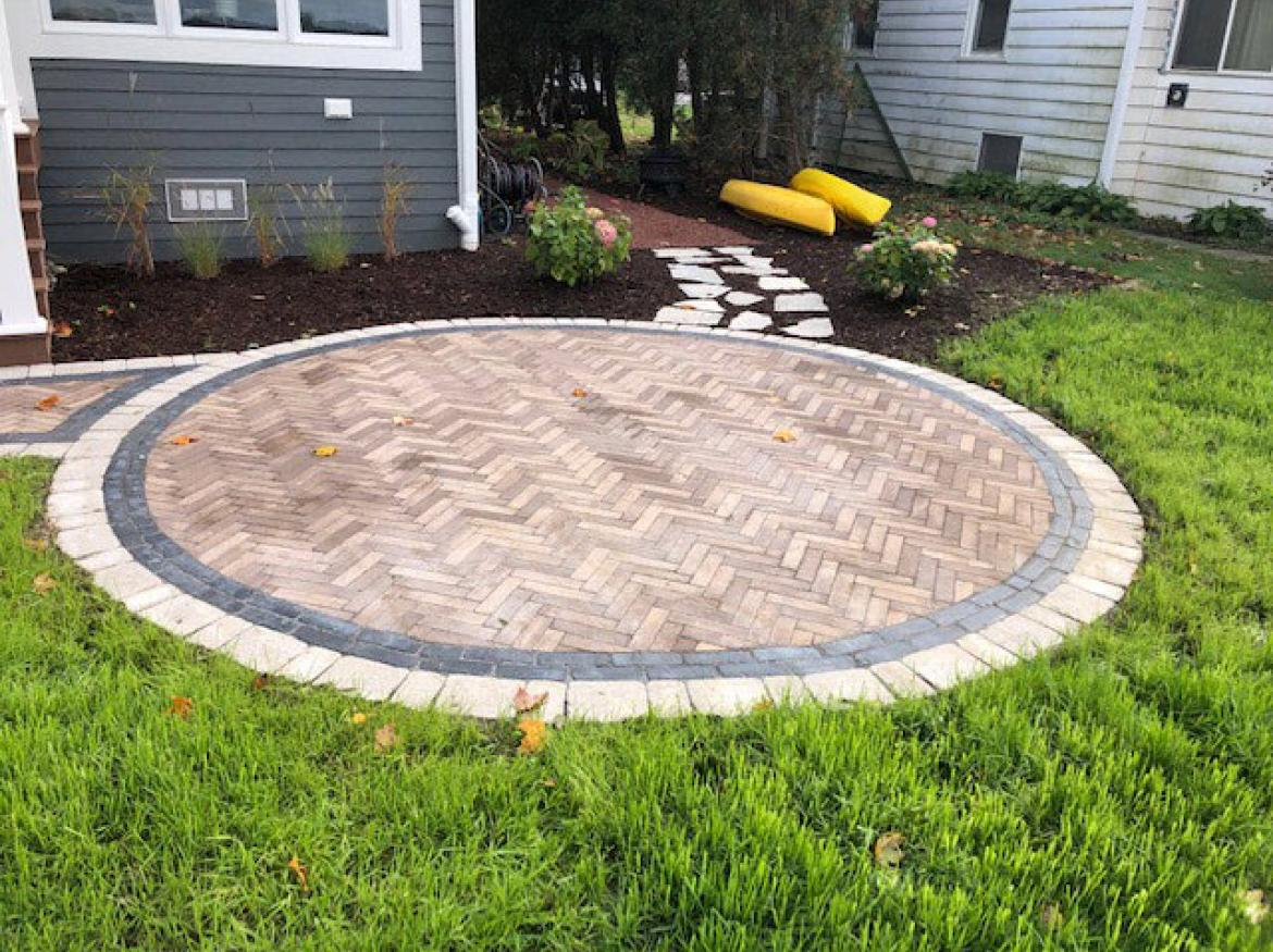Paver patio with accent border and fire pit (view A).