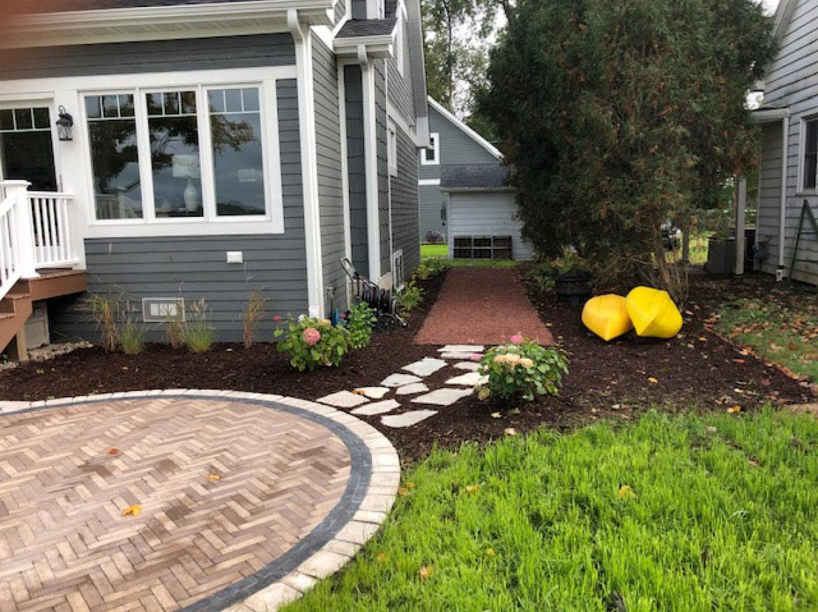 Paver patio with accent border and fire pit (view B).