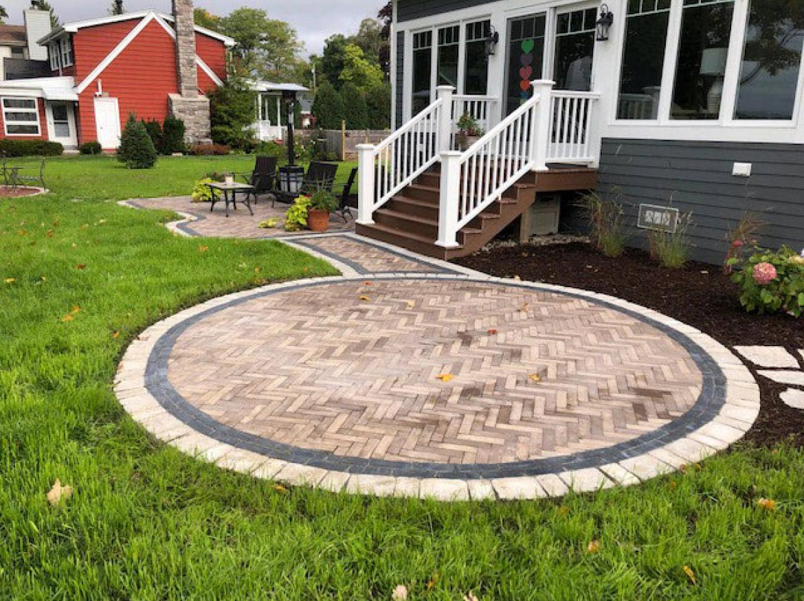 Paver patio with accent border and fire pit (view E).