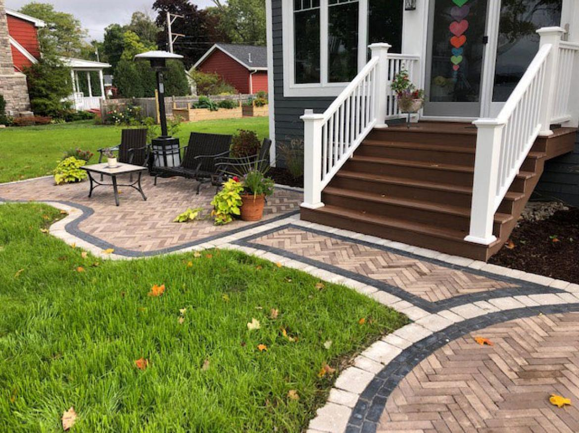 Paver patio with accent border and fire pit (view F).