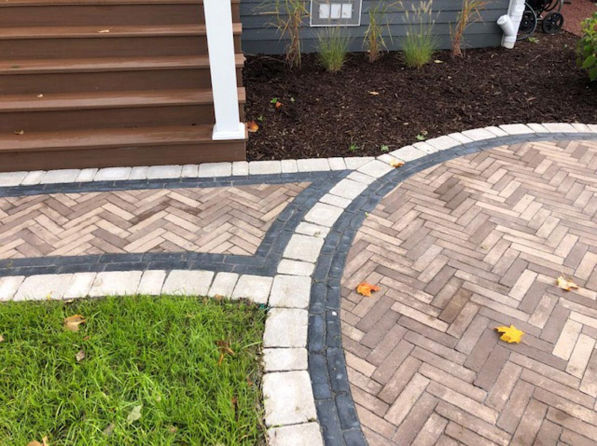 Paver patio with accent border and fire pit (view G).