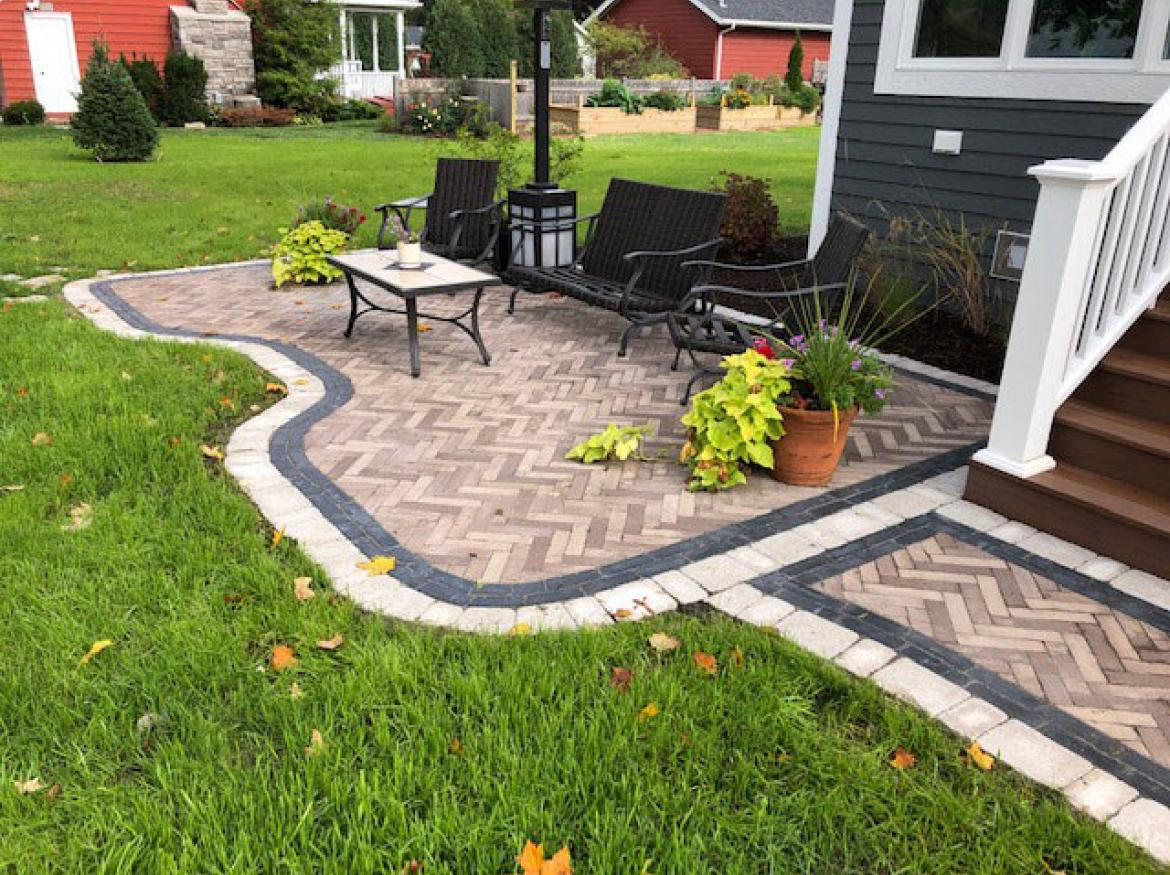 Paver patio with accent border and fire pit (view J).
